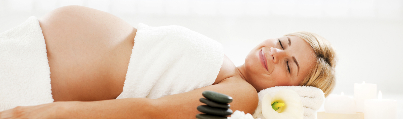 Young pregnant woman enjoying in spa treatment.